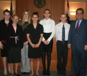 Brad Lear serves as volunteer presiding judge for 8th grade mock trial competition
